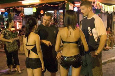 "Prostitutes talk to potential customers on the street in Pattaya, Thailand. ""Customers/exploiters come from all over the world. Legalized or tolerated prostitution is a magnet for sex trafficking. The U.S. Government considers prostitution to be ""inherently demeaning and dehumanizing"