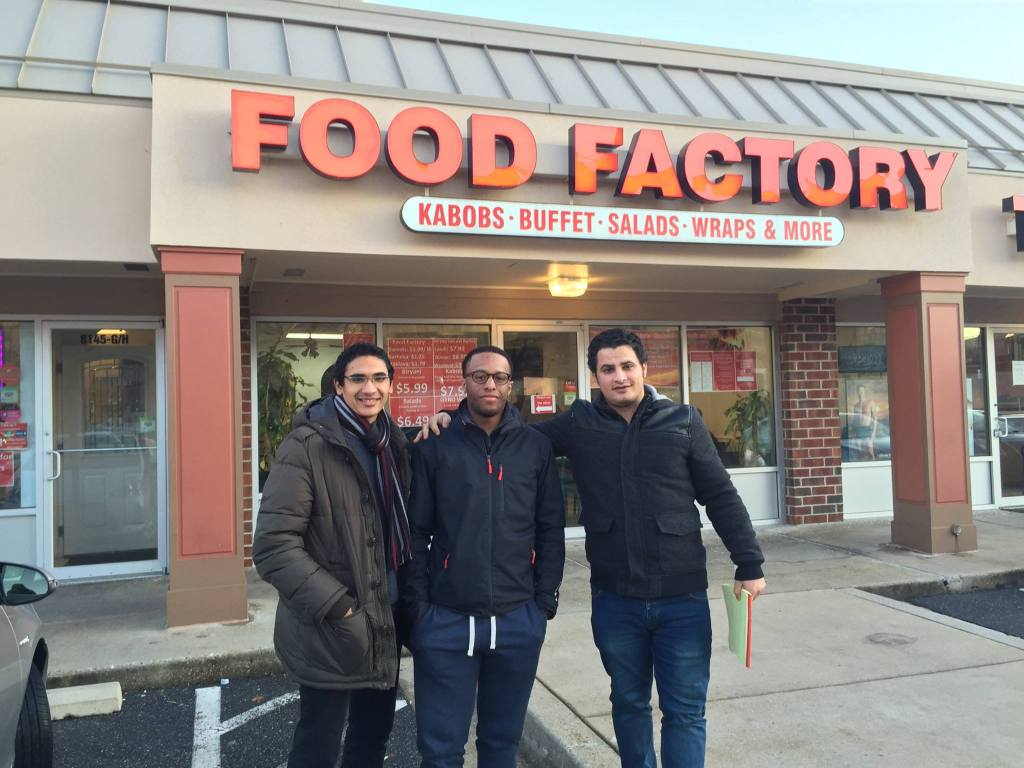 George Washington graduate student Ahmed Hassan, American University sophomore John Leo and senior Ali Muhamed stand in front of Food Factory on Saturday Jan 24. Food Factory is known for Mediterranean Cuisine. (Photo courtesy of Ali Muhamed)